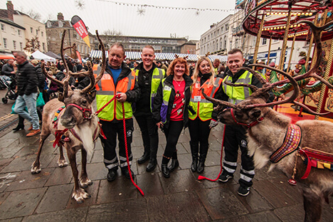 A group of CJ's Events works with reindeer
