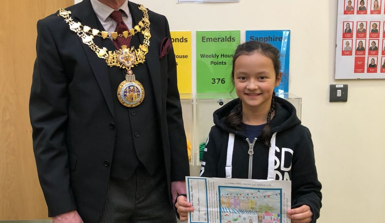 Warwick school girl creates winning design for new  festival boards